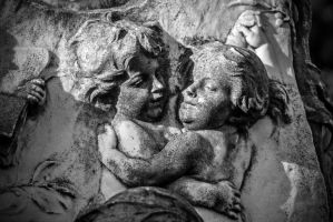 Kids hugging on a tombstone by attomanen