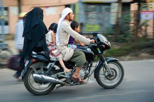 A family on a bike in Hyderabad India by lutfiuzun