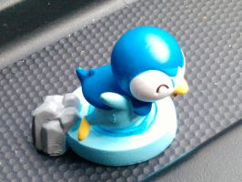 Piplup in a car by Quacksquared