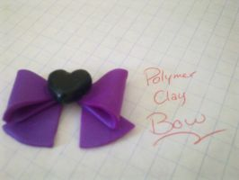 Purple Polymer clay bow by FullmetalDemigod