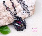 Black wire wrapped seashell pendant by IanirasArtifacts