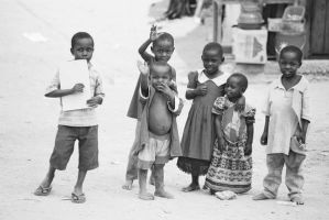 Happf African children waving by WhyJP