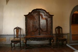 Armoire with chairs by almudena-stock