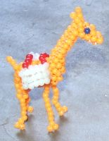 Beaded llama with baskets by Anabiyeni