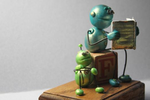 Robot reading to little robot by sillysarasue