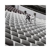 Children play at the stadium by ESDY