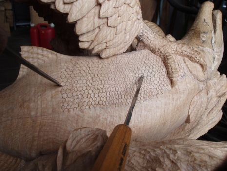 Woodcarver Eagle with salmon in progress 19 by woodcarve