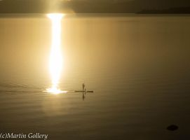 stand up paddling in the sunset by MartinGollery