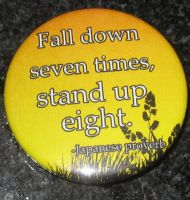 'Fall down seven times, stand up eight' button by BlackUnicornWood