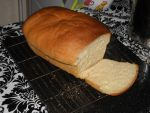 Crusty white bread, sliced by Bisected8