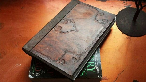 leather book by TwitchNothing