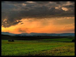 storm and sunset by DanielloPL