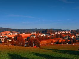 Small rural town skyline at sunrise by patrickjobst