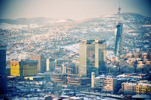 Snowy morning above the city by villewilson
