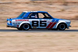Adam Carolla racing his BRE Datsun 510 by SharkHarrington