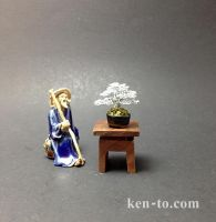 A bonsai vendor with his tree by KenToArt