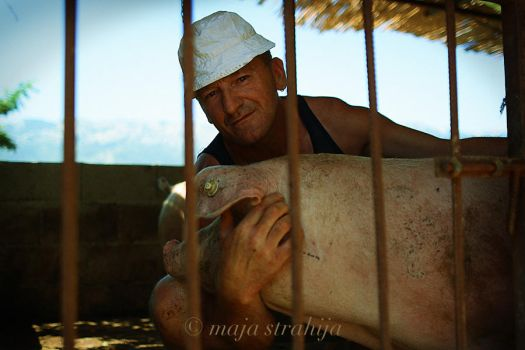 man and his pig by FearAndMe