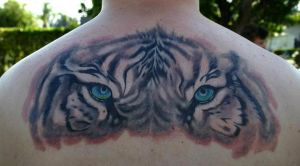 tiger eyes tattoo by twyliteskyz