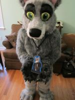 Showing off the Badge by SolitaryGrayWolf