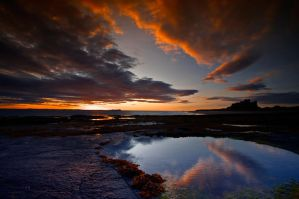 Dawn Rise Over Bamburgh Beach by lifecapture