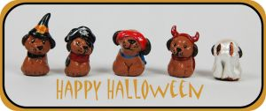 Halloween puppies by LeiliaClay