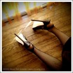 Heels Worn Against Wooden Floo by stevedietgoedde