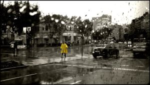 Man with a yellow raincoat by CabrerFoto