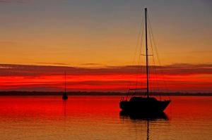 EC Red Hued River sailboat Sillouhette by Kippenwolf