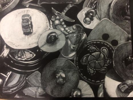 Charcoal pile of buttons.  by rebeliousartist
