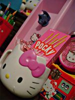 Hello Kitty Cup And Pocky by OkashiTi