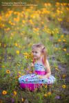 Child Smelling Flowers by Della-Stock