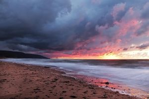 Red Glow Sunset and Waves by EvaMcDermott