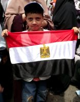 A Boy holding Egypt Flag by asiaibr
