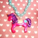 the pink and purple unicorn charm by Druovna