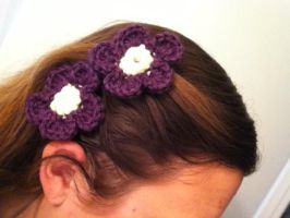 Purple and yellow crocheted flowers by VashandNaomiForever