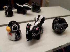 Penguin, skunk and black lion by JillyFoo