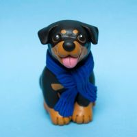 Winter rottie dog sculpture by SculpyPups