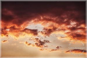 Dramatic sunset clouds by Ankh-Infinitus