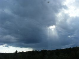storm clouds with a sun ray by BlueIvyViolet