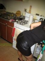 Bending over in leather skirt by Girl-q