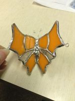 Orange butterfly top view by squatalopicous