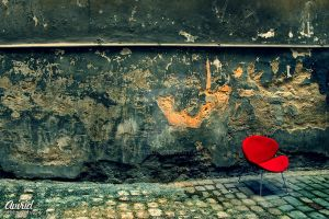 red chair on the street by avirid