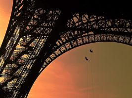 Climbing on the Eiffel Tower by Anneurin