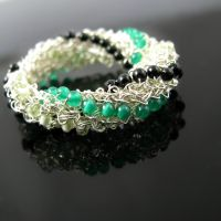 Twist of luck wire crochet ring by CatsWire