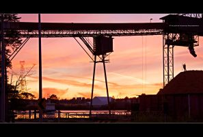 Working at Sunset by Val-Faustino