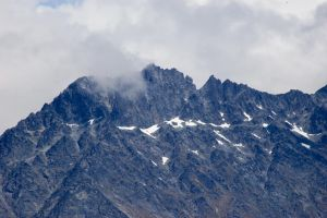 NZ Mountain peak little snow clouds by Chunga-Stock