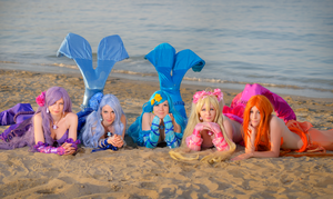 Mermaids on the shore by VampireIonFortuna