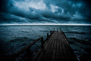 Dark Wooden Pier by tuebengtsson