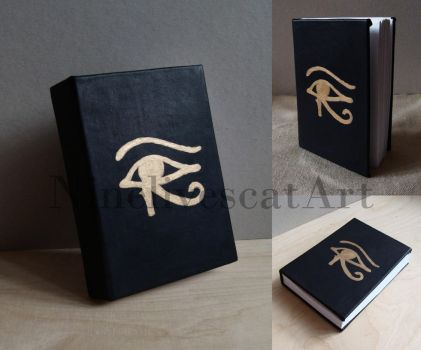 Leather notebook with eye of Horus by NinelivescatArt