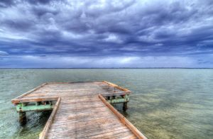 Crooked Pier over Green Water by Blaklisted